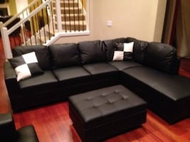 Black leather sectional couch and ottoman