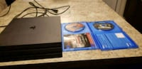 black Sony PS4 game console with games 33 mi