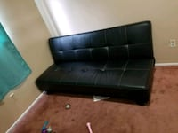 black leather tufted sofa with ottoman