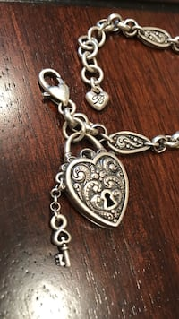 silver-colored charm bracelet with lobster locki
