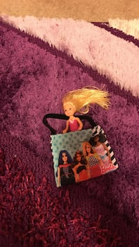 Cute chelsea in Barbie purse together