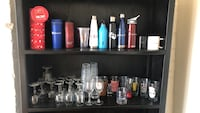 Assorted glassware and water bottles.