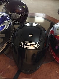 Four assorted color full face helmets Moose Jaw, S6H 7J5