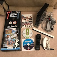 Black nintendo wii system console with controller cables and 4 games Burtonsville, 20866