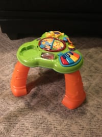 baby's green and orange plastic learning table