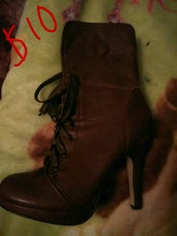 unpaired brown leather stiletto boots