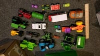 Toy trucks, tractors, and cars