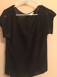 Medium black blouse with button detail on back. Minimal wear   Dallas, 30132
