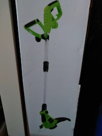 green and black electric string trimmer 543 mi