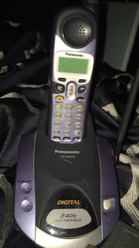 purple and black Panasonic cordless phone