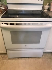 White and black induction range oven Surrey, V3W 2M7