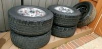 four gray 5-spoke vehicle wheels and tires Laurel