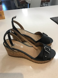 Women's pair of black Aldo ankle strap wedge sandals
