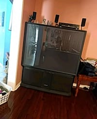 black flat screen TV with black wooden TV stand Brampton, L7A 2M5