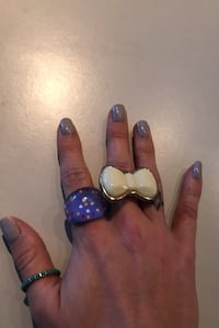 Gold bow tie ring.