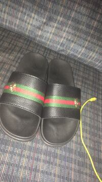 pair of black Gucci slide sandals Ajax, L1Z