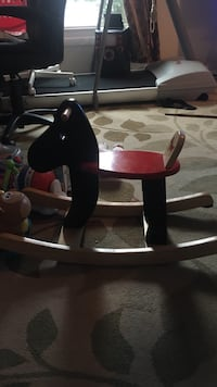 Toddler's brown and red wooden rocking horse Sterling, 20164