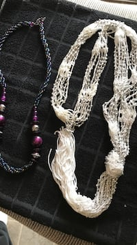 two white and purple necklaces