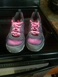 pair of pink-and-gray running shoes Painted Post
