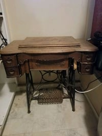 new homes sewing machine and table