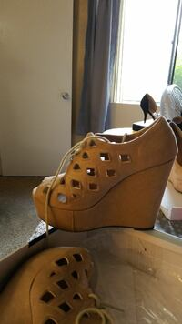 pair of women's brown leather strappy peep-toe wedge sandals