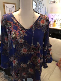 Reneec. Printed top with ruffle sleeve size M  West Long Branch, 07764