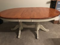 oval brown wooden pedestal table