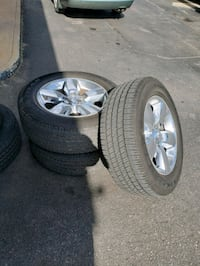three gray 5-spoke vehicle wheel and tires 28 mi