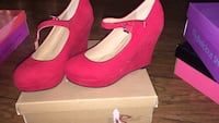 Pair of women's red sued wedges
