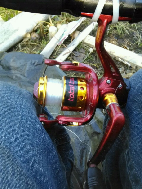 red and black fishing reel