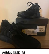 Pair of black adidas with box null