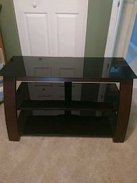 brown wooden framed glass top TV stand Concord, 28027