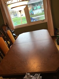 rectangular brown wooden table with chairs dining set