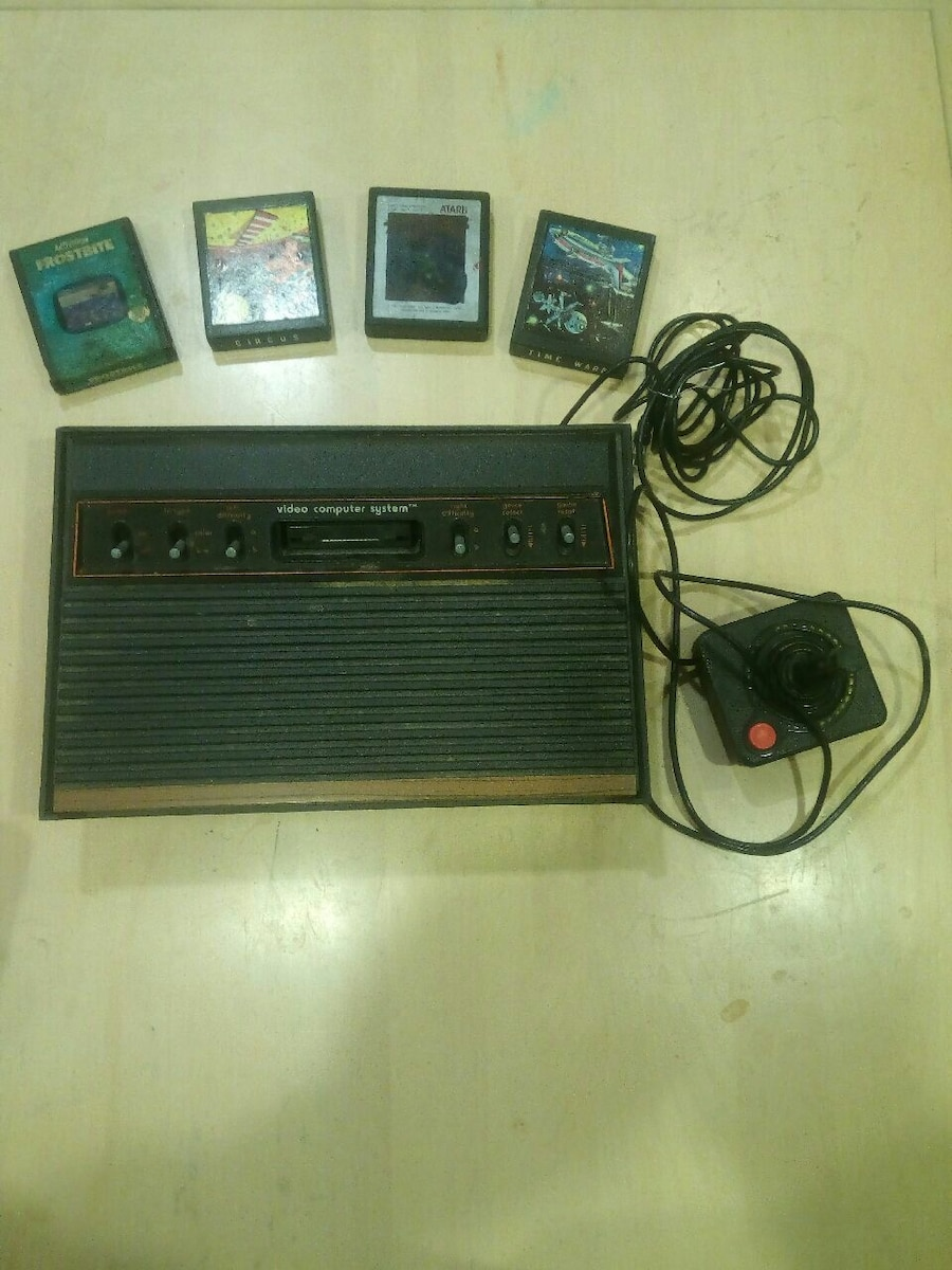 black and brown Atari with four game cases for sale  Vaughan
