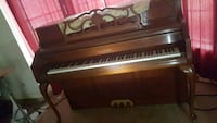 brown wooden framed upright piano Houston, 77088