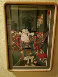 Oriental cloth print with wooden frame