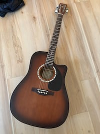 Acoustic guitar with tuner Vancouver, V6Z 1B8