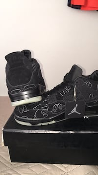 pair of black-and-white Air Jordan basketball shoes with box
