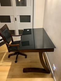 black wooden desk with rolling chair New York, 10016