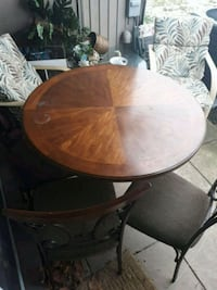 round brown wooden table with four chairs dining set Dundalk, 21222