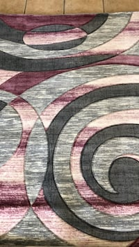White, black, and pink area rug