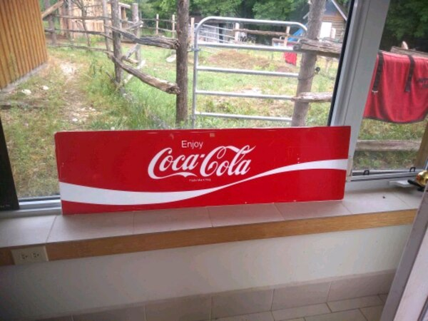 red and white Coca-Cola commercial refrigerator
