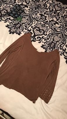 brown boat neck long sleeve shirt