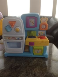 Toddler's white and blue kitchen playset