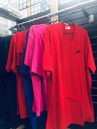 red and blue Nike polo shirts