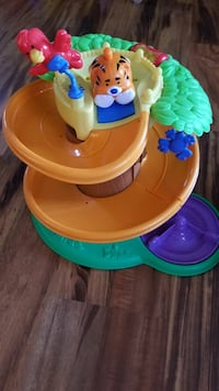 toddler's beige, green, and red animal themed spiral track toy