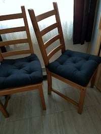 Two wooden chairs with cushions Thorold, L0S 1A0