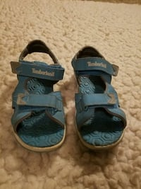 pair of blue-and-black sandals Stone Mountain, 30088