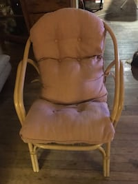 VINTAGE WICKER CHAIR WITH PINK CUSHION.