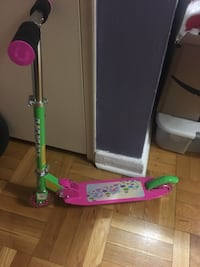 toddler's pink and green Kick scooter